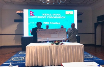 EAM and FM of Nepal witnessed handing over of cheque of NPR 2.45 billion towards reimbursement to GON for housing reconstruction in Nuwakot and Gorkha Districts during  the 5th JCM held in Kathmandu.