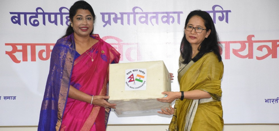 Deputy Chief of Mission of the Embassy of India, Ms. Namgya C. Khampa, handed over consignments of flood and landslide relief material worth NPR 8 Crore to Ms. Chanda Chaudhary, Hon. Member of Parliament and President of the Nepal-India Women Friendship Society (NIWFS)